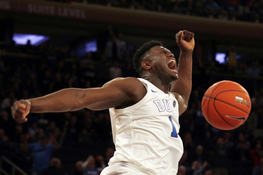 File- This Dec. 20, 2018, file photo shows Duke forward Zion Williamson (1) dunking the ball against Texas Tech during the first half of an NCAA colle...