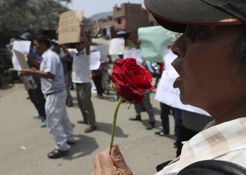 Relatives protest as Peruvian authorities demolish a Shining Path mausoleum in a cemetery on the outskirts of Lima, Peru, Saturday, Dec. 29, 2018. Per...