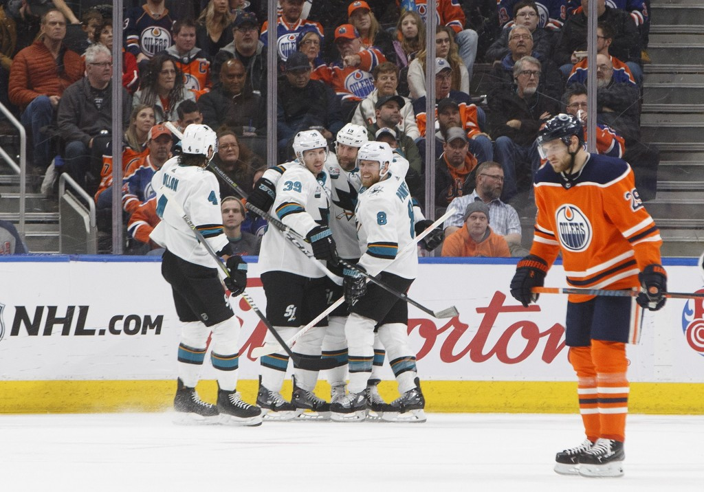 San Jose Sharks celebrate a goal as Edmonton Oilers' Leon Draisaitl (29) skate past during the second period of an NHL hockey game, Saturday, Dec. 29,...