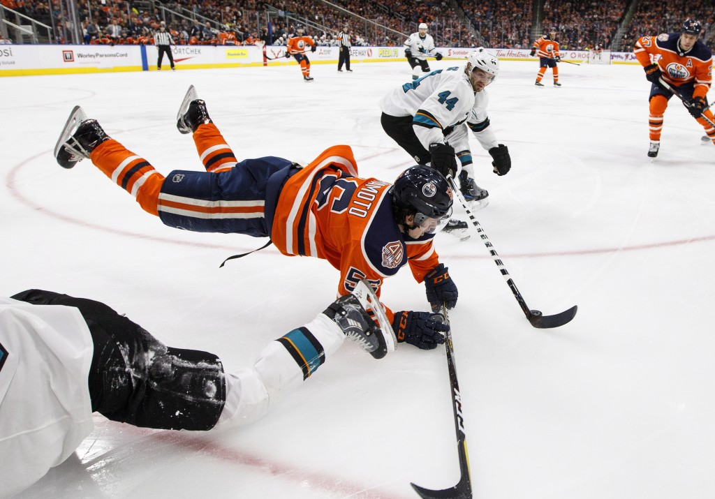 San Jose Sharks' Marc-Edouard Vlasic (44) takes the puck as Edmonton Oilers' Kailer Yamamoto (56) is tripped up during the second period of an NHL hoc...
