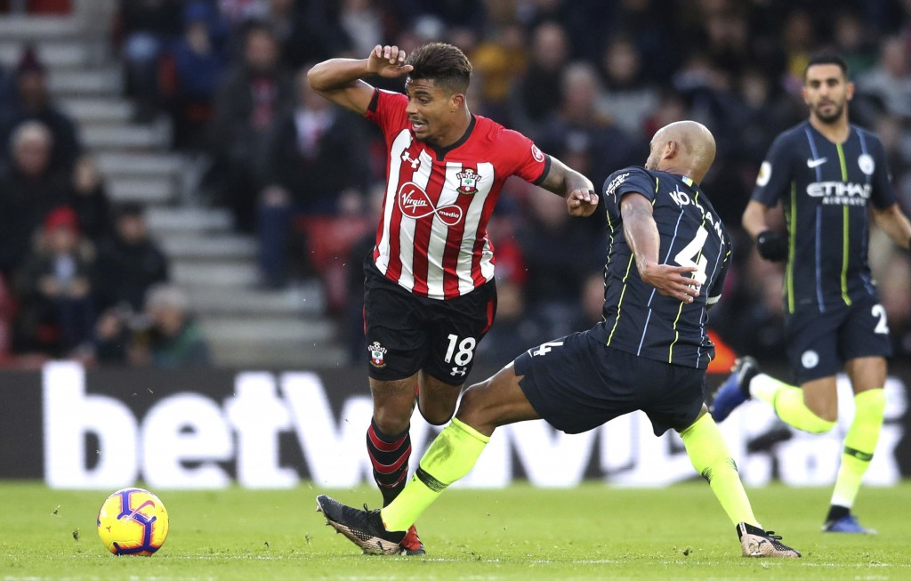 Manchester City's Vincent Kompany, right, tackles Southampton's Mario Lemina, during their English Premier League soccer match at St Mary's Stadium in...