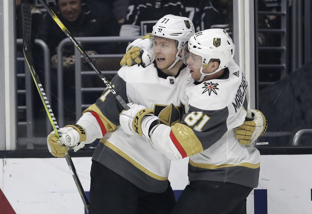 Vegas Golden Knights' William Karlsson, left, celebrates his goal with teammate Jonathan Marchessault during the third period of an NHL hockey game ag...