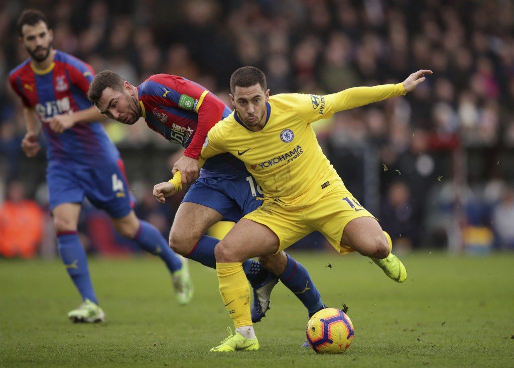 Chelsea's Eden Hazard and Crystal Palace's James McArthur, left, during their English Premier League soccer match at Selhurst Park in London, Sunday D...