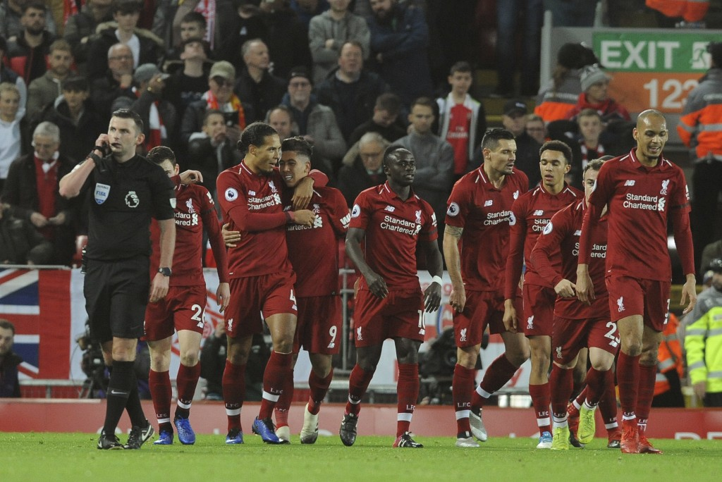 Liverpool's Roberto Firmino, (at centre, No 9) celebrates with teammates after scoring his sides 1st goal during the English Premier League soccer mat...