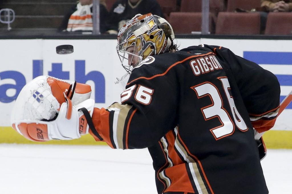 Anaheim Ducks goaltender John Gibson blocks a shot during the first period of an NHL hockey game against the Arizona Coyotes in Anaheim, Calif., Satur...