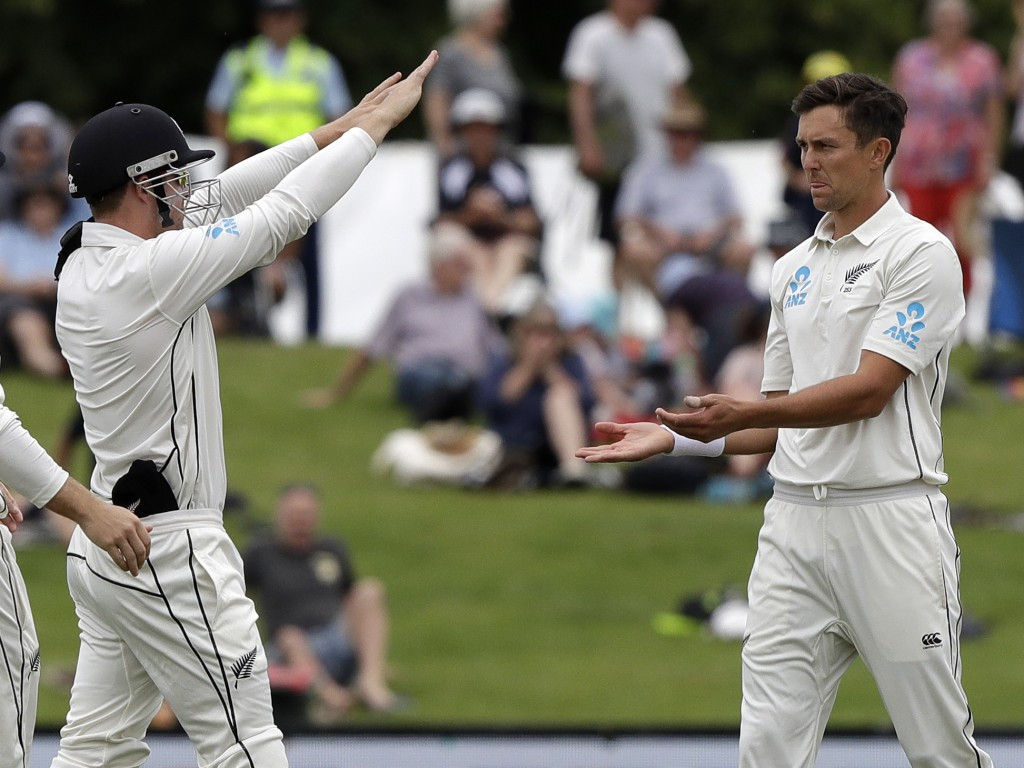 New Zealand's Henry Nicholls, left, congratulates bowler Trent Boult after the dismissal Sri Lanka's Dushmantha Chameera during play on the final day ...