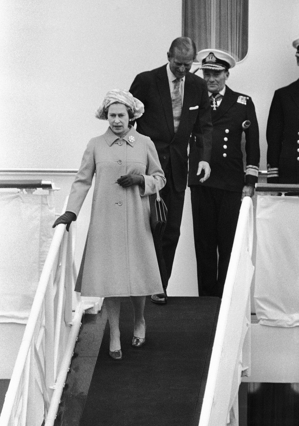FILE - In this file photo dated Thursday, May 25, 1978, Britain's Queen Elizabeth II and Prince Philip leave the Royal Yacht Britannia for a stopover ...