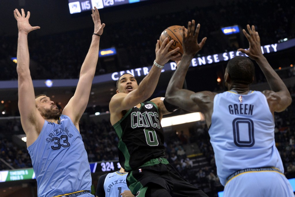 Boston Celtics forward Jayson Tatum, center, controls the ball between Memphis Grizzlies center Marc Gasol (33) and forward JaMychal Green, right, dur...