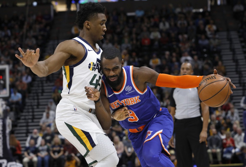 New York Knicks' Tim Hardaway Jr. (3) drives to the basket as he is defended by Utah Jazz's Donovan Mitchell, left, in the first half of an NBA basket...