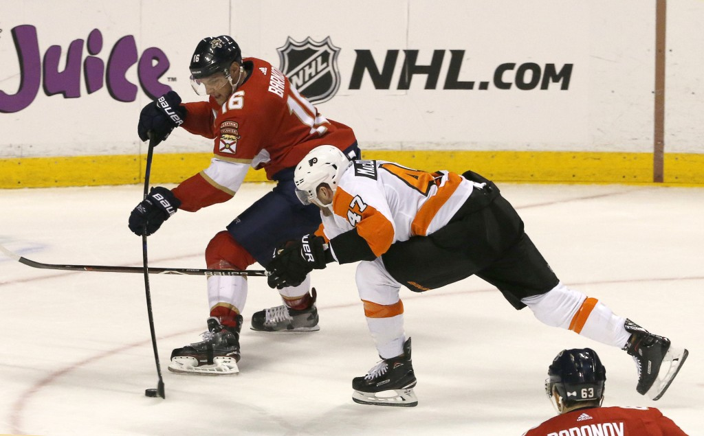 Florida Panthers center Aleksander Barkov (16) shoots under pressure from Philadelphia Flyers defenseman Andrew MacDonald (47) in the second period of...