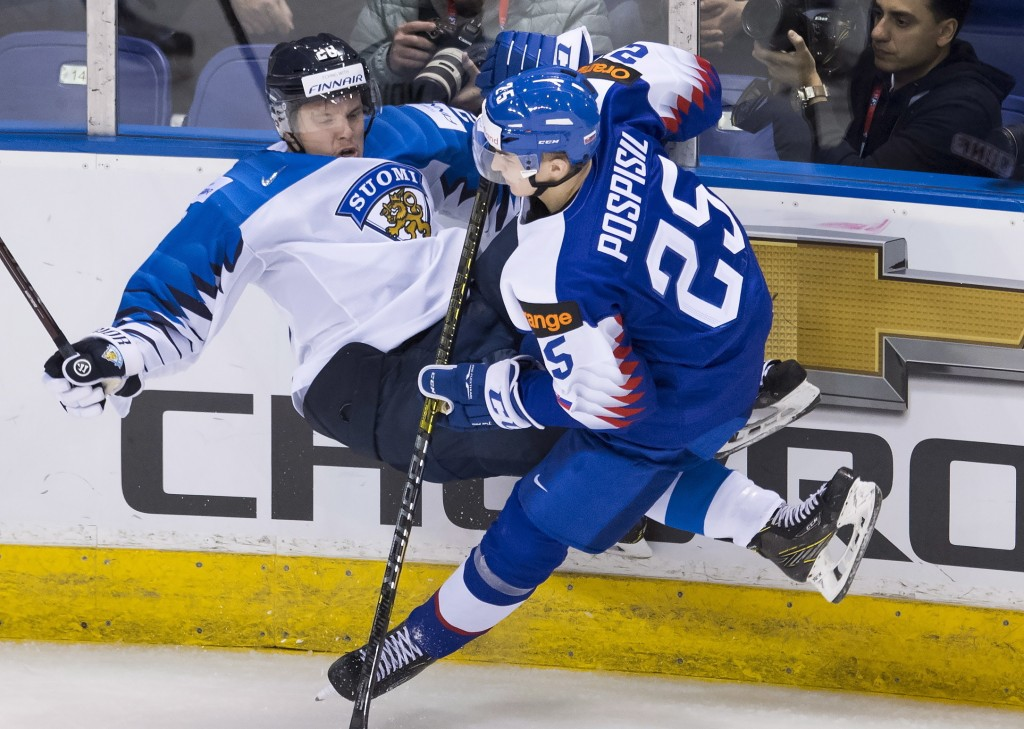Finland's Sami Moilanen (28) gets thrown into the boards by Slovakia's Martin Pospisil (25) during the third period of a world junior hockey champions...