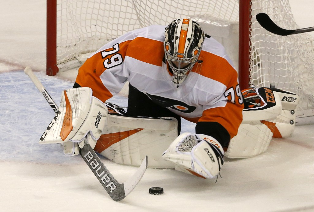 Philadelphia Flyers goaltender Carter Hart (79) makes a second period save against the Florida Panthers in an NHL hockey game, Saturday Dec. 29, 2018,...