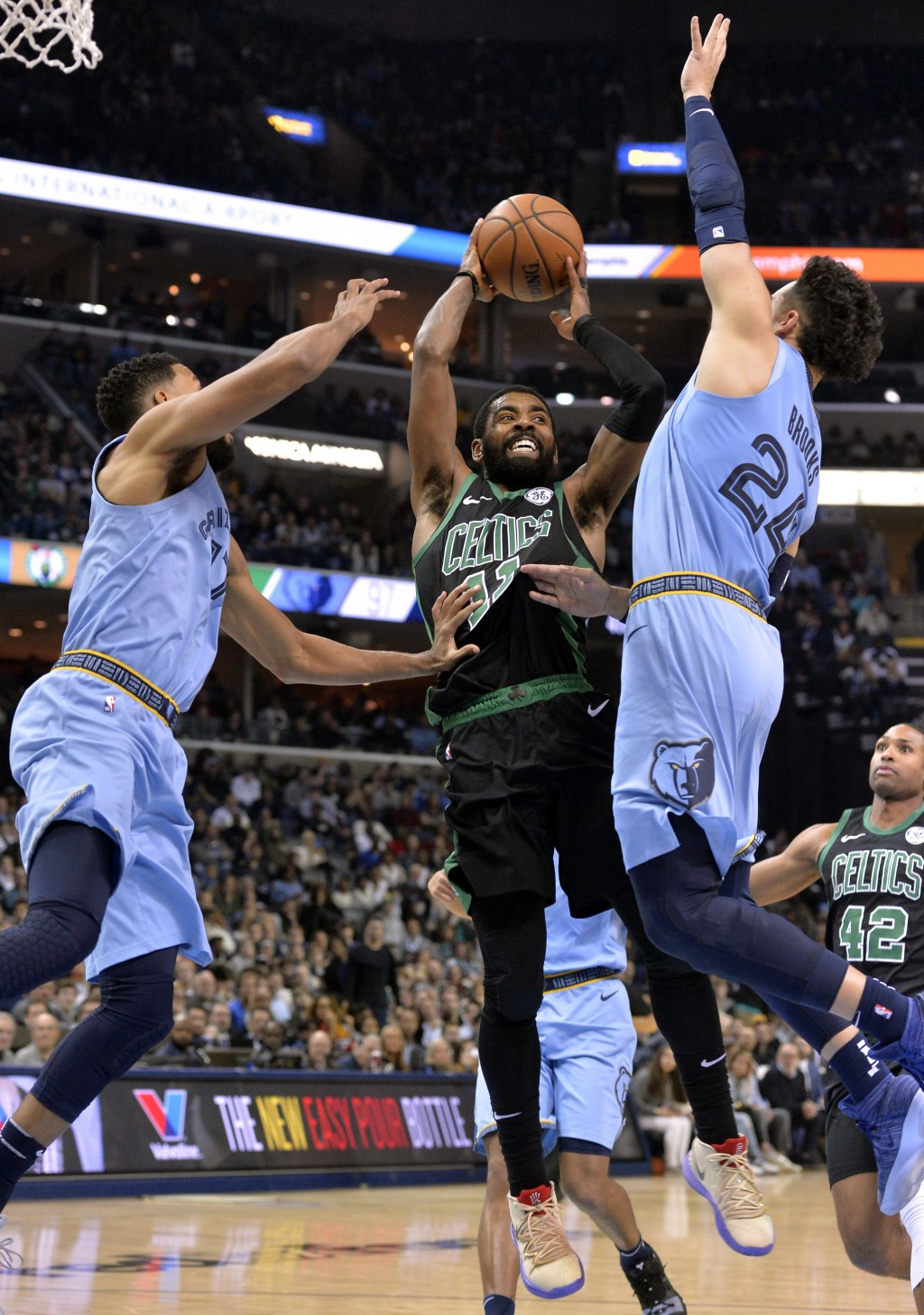 Boston Celtics guard Kyrie Irving (11) controls the ball between Memphis Grizzlies guards Garrett Temple (17) and Dillon Brooks (24) during the second...