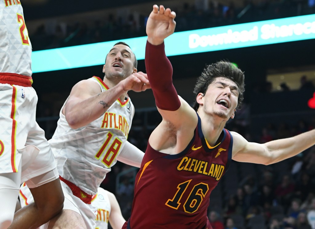 Cleveland Cavaliers forward Cedi Osman (16) reacts after being fouled while shooting against the Atlanta Hawks during the first half of an NBA basketb...