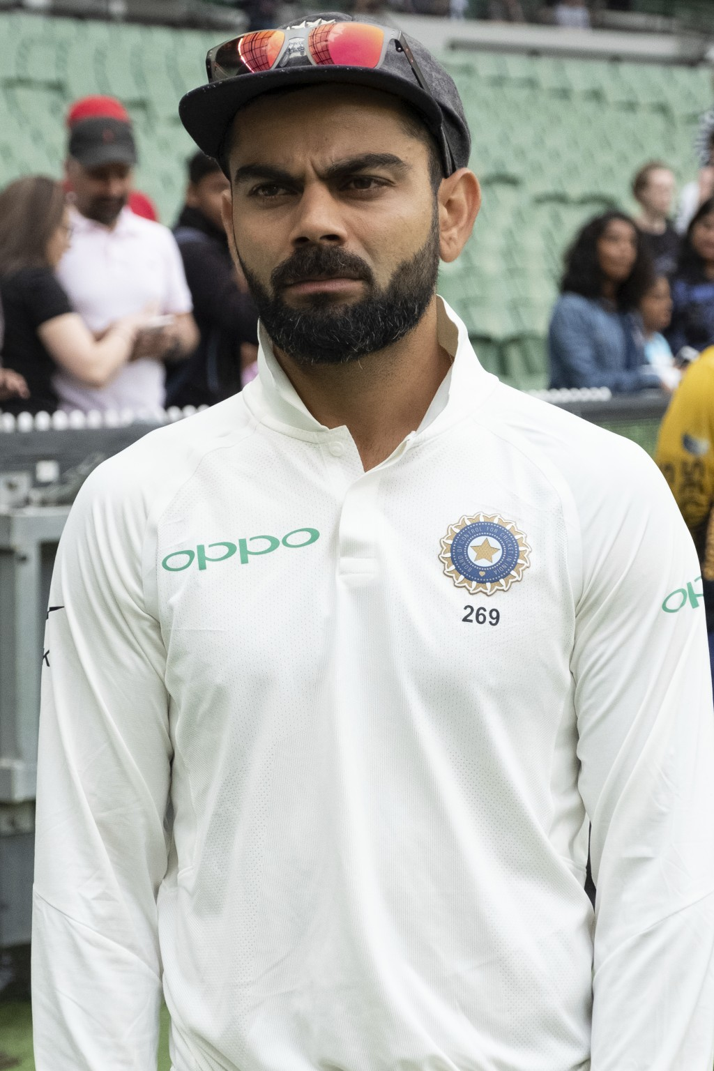 India's Virat Kohli on the sideline awaits the commencement of play during day five of the third cricket test between India and Australia in Melbourne...