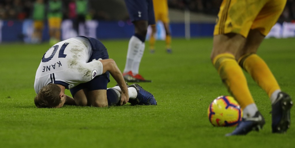 Tottenham Hotspur's Harry Kane lies on the ground after a tackle by Wolverhampton Wanderers Ivan Cavaleiro, but his booked for diving, during their En...