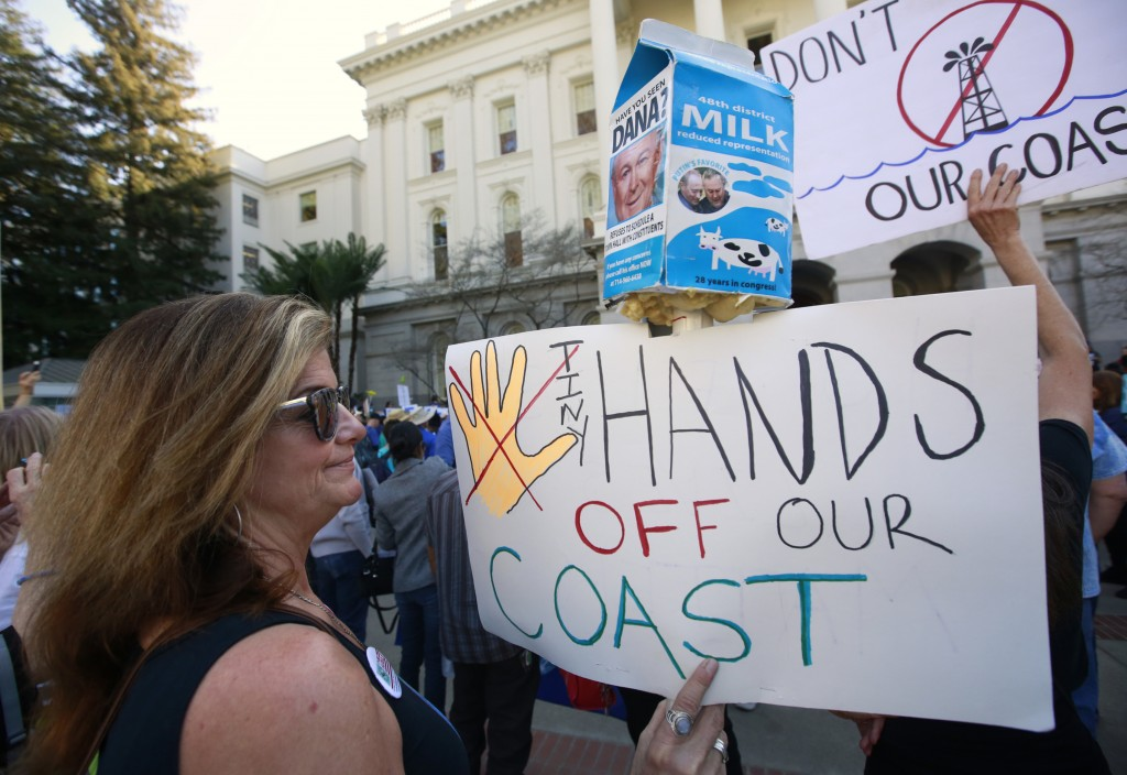 FILE - In this Feb. 8, 2018, file photo, Bethany Webb, of Huntington Beach, joins other protesters at a rally against oil drilling off the California ...