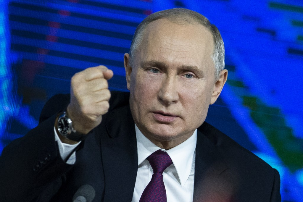 FILE In this file photo taken on Thursday, Dec. 20, 2018, Russian President Vladimir Putin gestures during his annual news conference in Moscow, Russi...