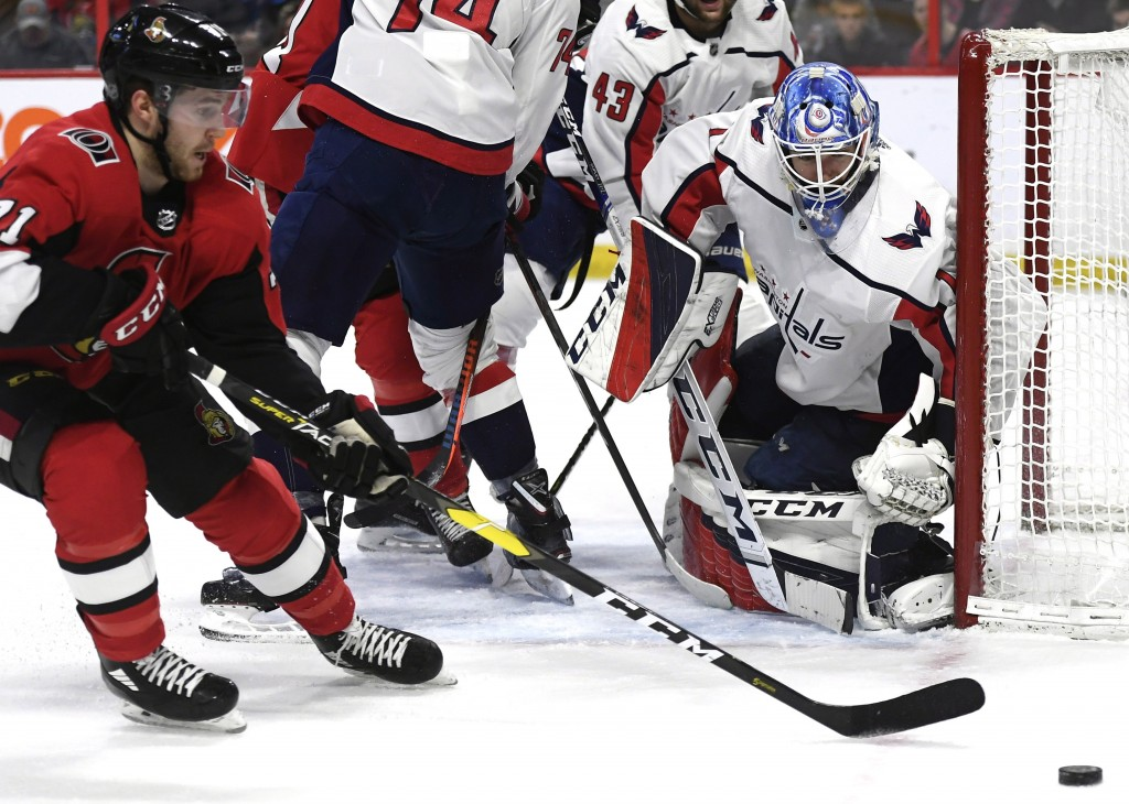 Washington Capitals goaltender Pheonix Copley (1) watches the puck as Ottawa Senators center Chris Tierney (71) tries to control it during the second ...