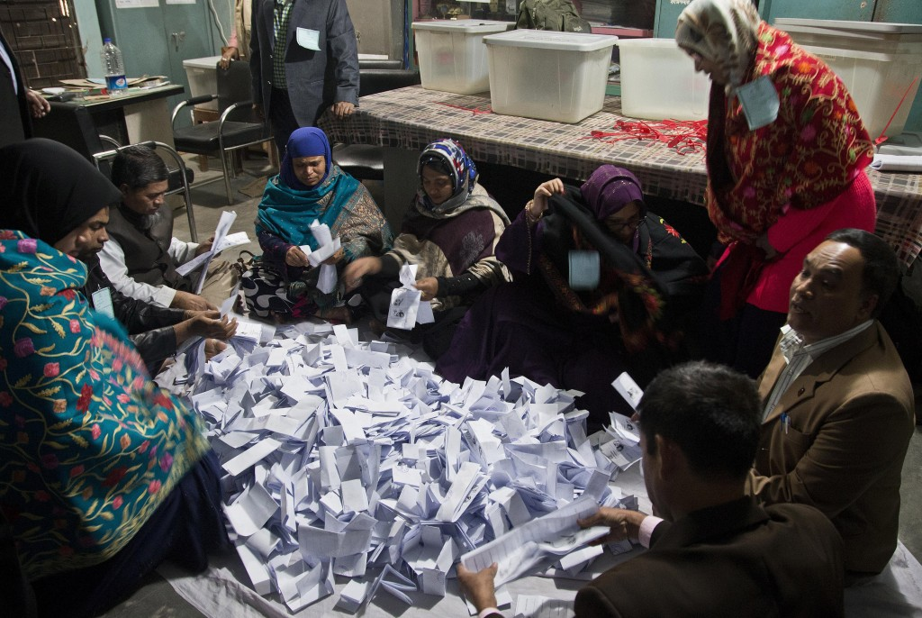Bangladeshi polling officials count ballots shortly after voting ended at a polling station in the ancient city of Panam Nagar, about 20 kilometers (1...