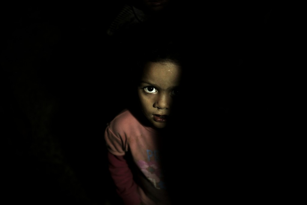 A child stands in a room at a shelter for displaced persons in Ibb, Yemen, in this Aug. 3, 2018, photo. Despite a massive international relief effort,...