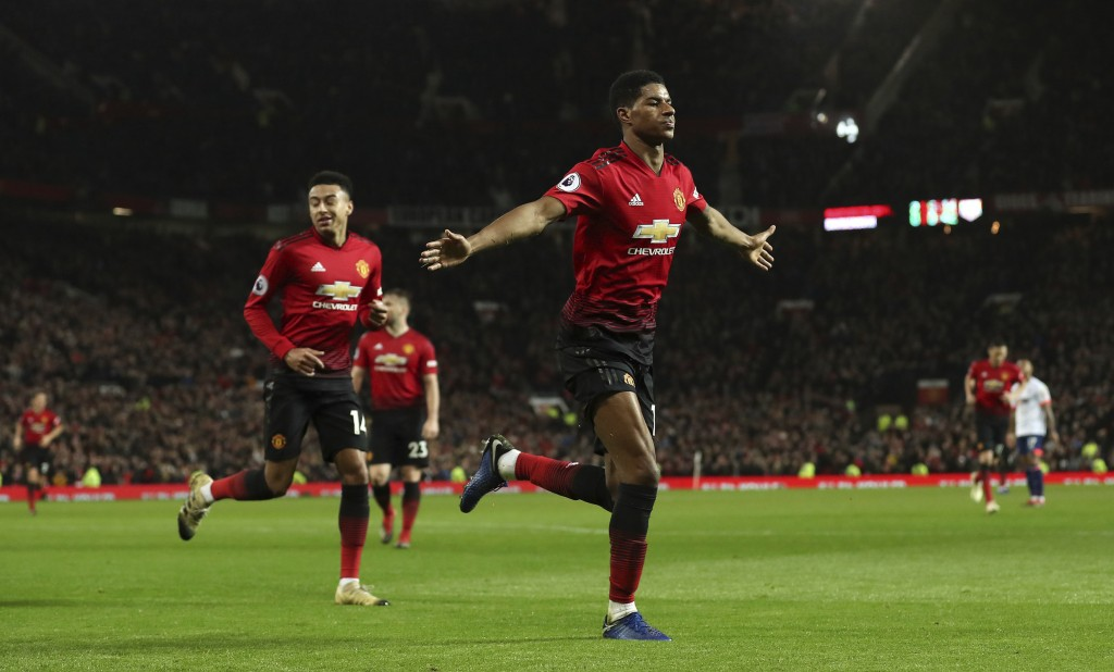 Manchester United's Marcus Rashford celebrates scoring his side's third goal of the game during the English Premier League soccer match between Manche...