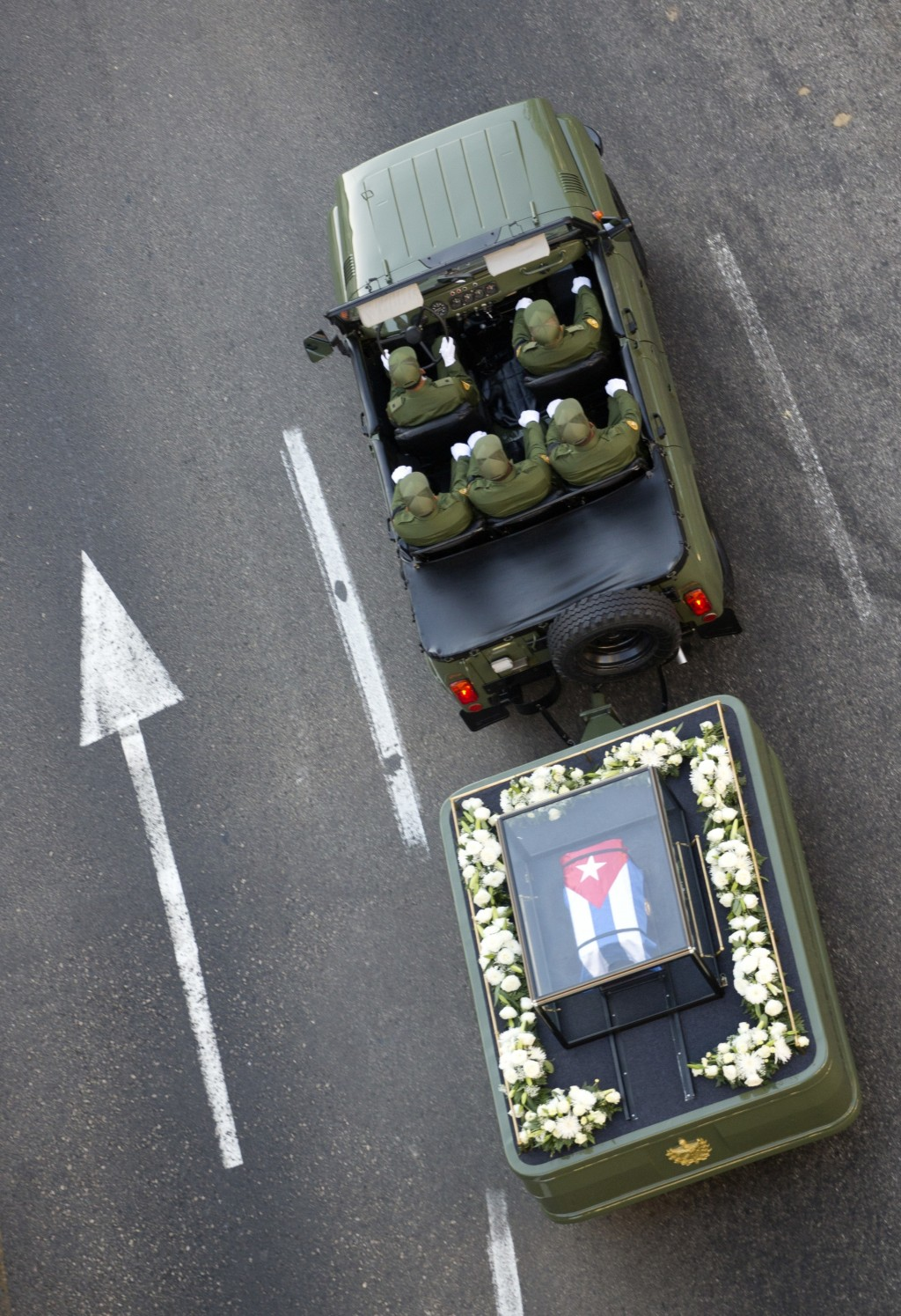 FILE - In this Nov. 30, 2016 file photo, a small, Cuban flag covered coffin containing the remains of Cuban leader Fidel Castro is pulled by a militar...