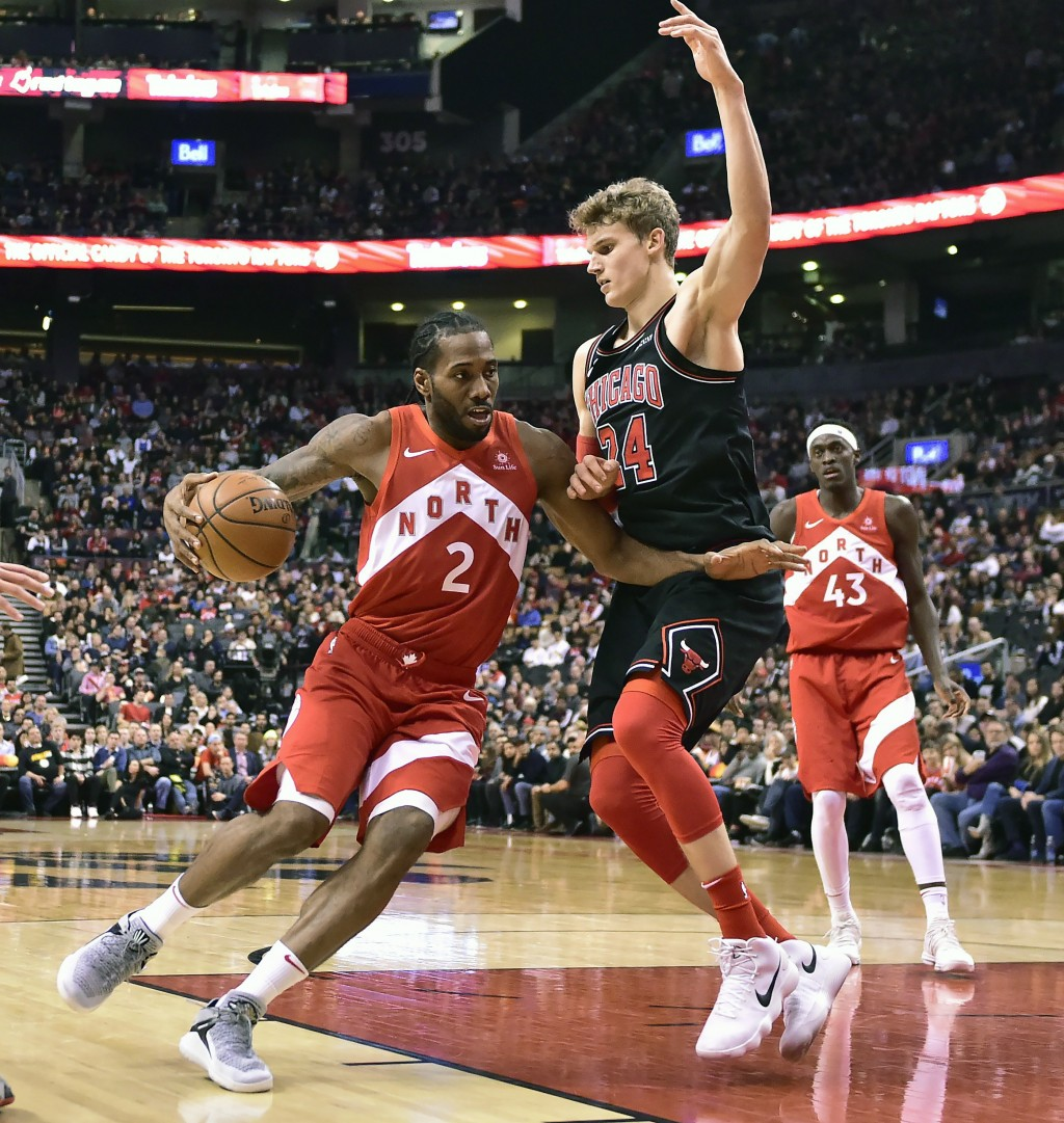Toronto Raptors forward Kawhi Leonard (2) drives to the net against Chicago Bulls forward Lauri Markkanen (24) during the second half of an NBA basket...