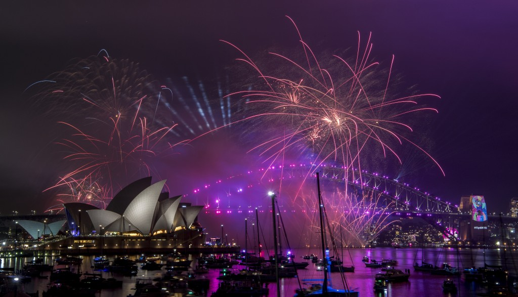 Fireworks explode over the Sydney Harbour during the New Year's Eve celebrations in Sydney, Monday, Dec. 31, 2018. (Brendan Esposito/AAP Image via AP)
