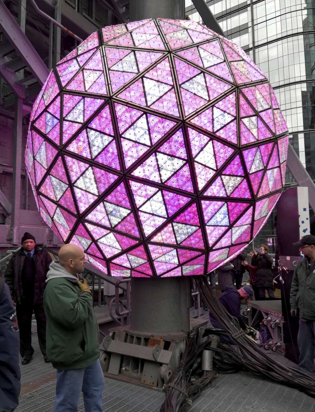 Workers in New York's Times Square perform a test on Sunday, Dec. 30, 2018, of the New Year's Eve ball that will be lit and sent up a 130-foot pole at...