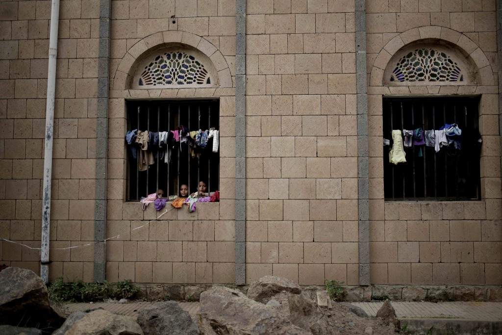 Children look out of their room at a shelter for displaced persons in Ibb, Yemen, in this Aug. 3, 2018, photo. Even with food aid that makes it into Y...