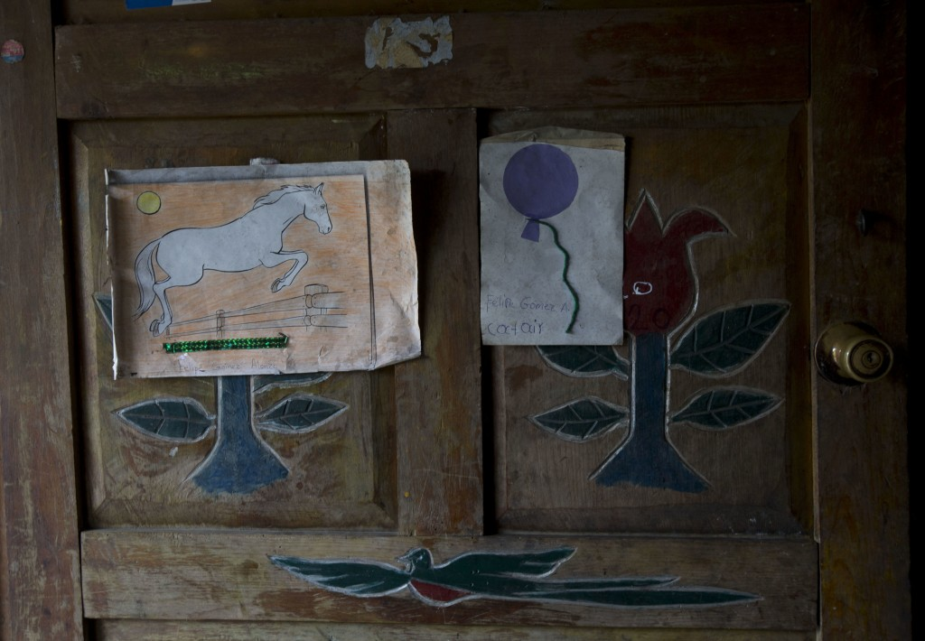 Artwork by Felipe Gomez Alonzo, an 8-year-old Guatemalan boy who died in U.S. custody, is taped to a door of the Gomez home in Yalambojoch, Guatemala,...