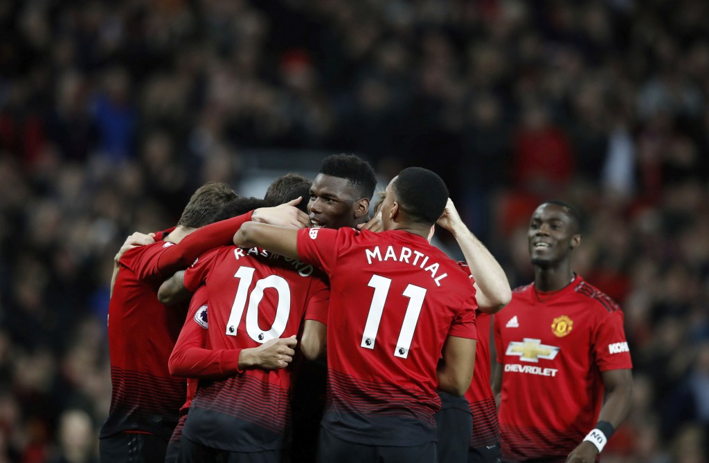 Manchester United's Paul Pogba, centre, celebrates with teammates after scoring his side's first goal of the game against Bournemouth, during their En...