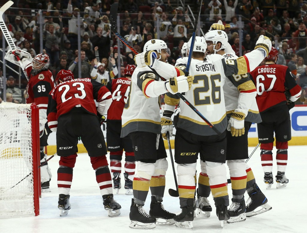 Vegas Golden Knights center Paul Stastny (26) celebrates his goal against the Arizona Coyotes with left wing Valentin Zykov (73) and right wing Alex T...
