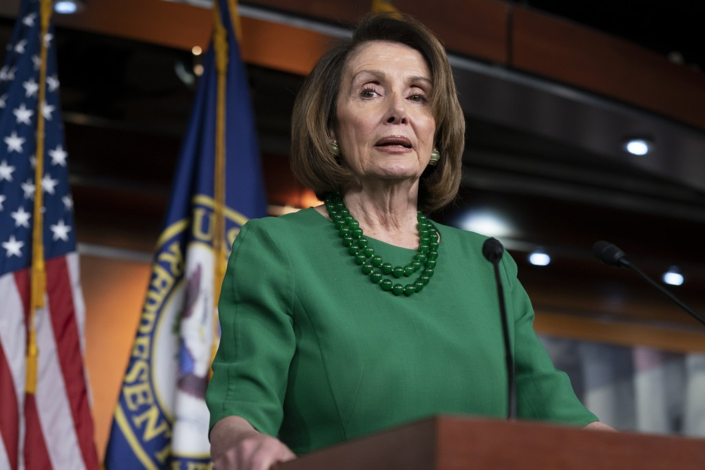 FILE - In this Thursday, Dec. 20, 2018 file photo, House Democratic Leader Nancy Pelosi of California, talks to reporters as Congress tries to pass le...