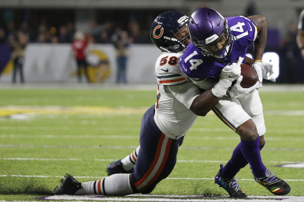 Minnesota Vikings wide receiver Stefon Diggs (14) tries to break a tackle by Chicago Bears inside linebacker Roquan Smith, left, during the second hal