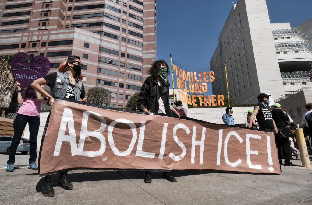 "FILE - In this July 2, 2018, file photo, protesters display a sign that reads ""Abolish ICE"" during a rally in front of the Immigration and Customs Enf..."