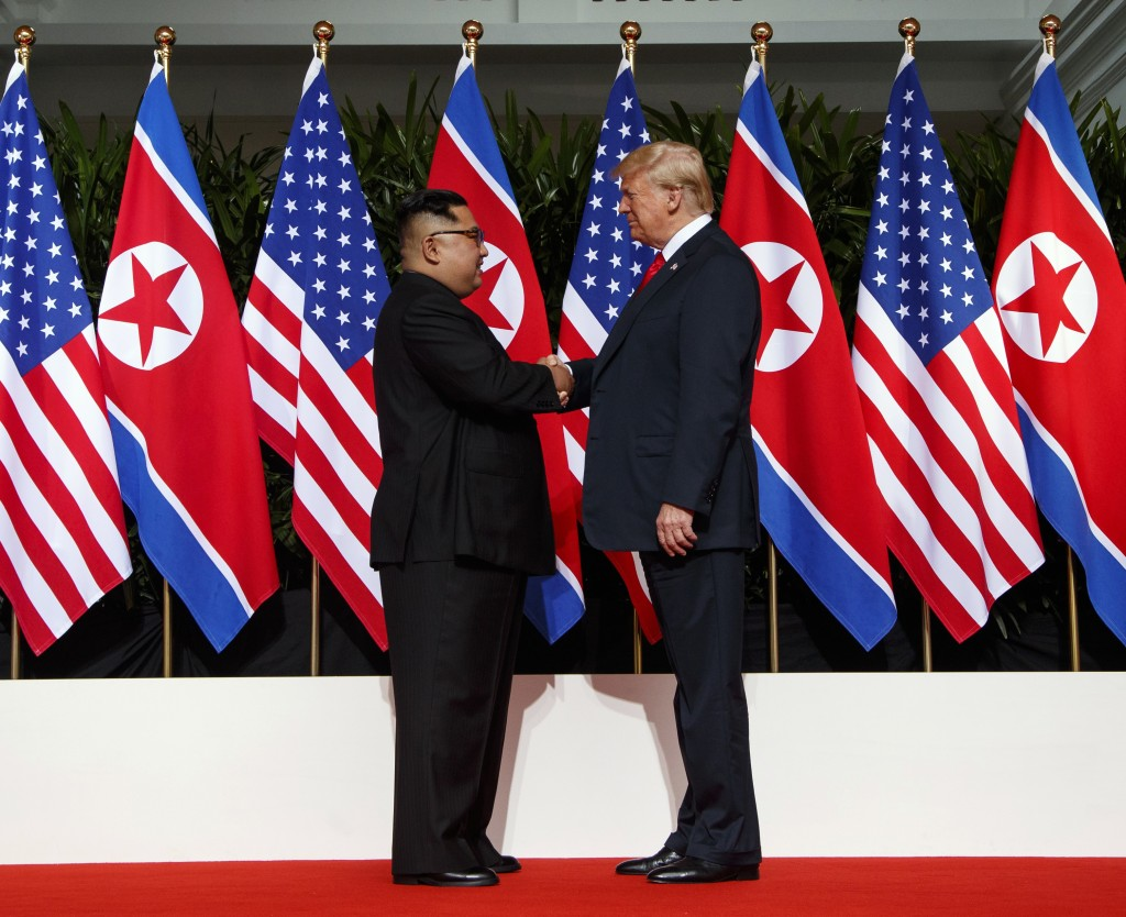 FILE - In this June 12, 2018, file photo, North Korean leader Kim Jong Un, left, and U.S. President Donald Trump shake hands prior to their meeting on