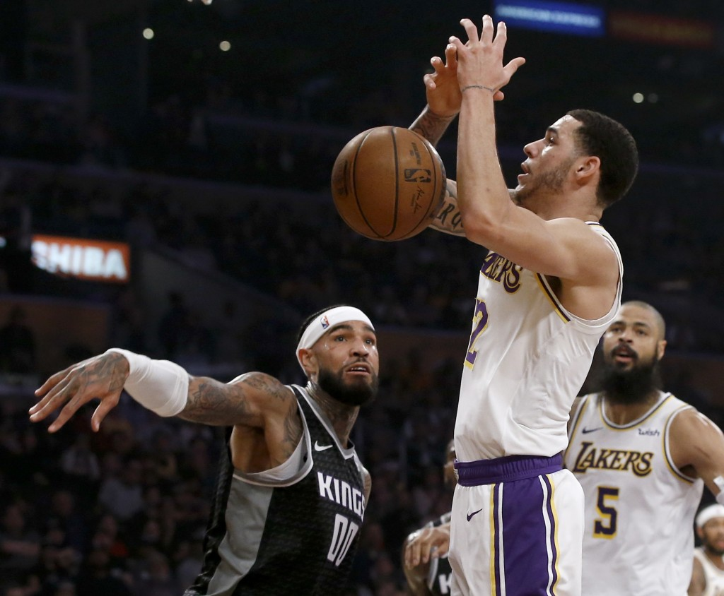 Sacramento Kings center Willie Cauley-Stein, left, knocks the ball away from Los Angeles Lakers guard Lonzo Ball, center, with center Tyson Chandler, ...