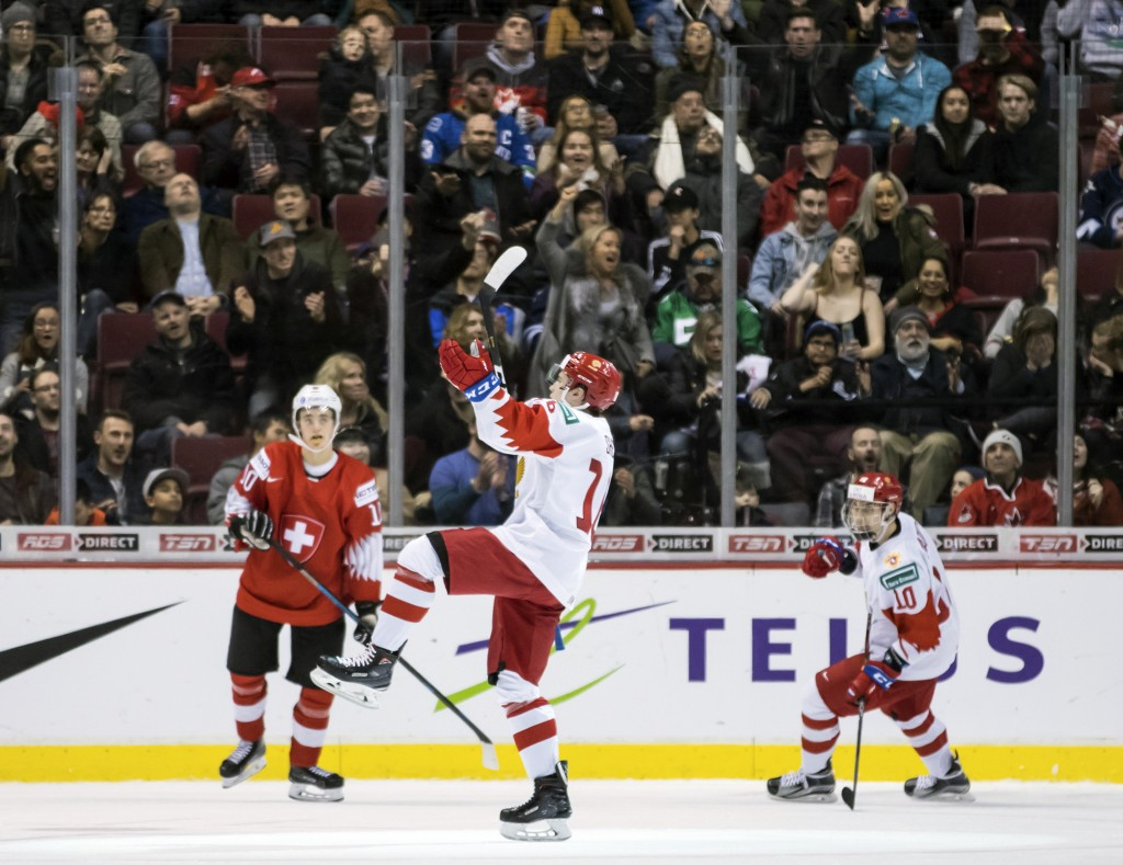 Russia's Pavel Shen, center, and Stepan Starkov, right, celebrate Shen's goal as Switzerland's Yannick Bruschweiler, left, watches during the third pe...
