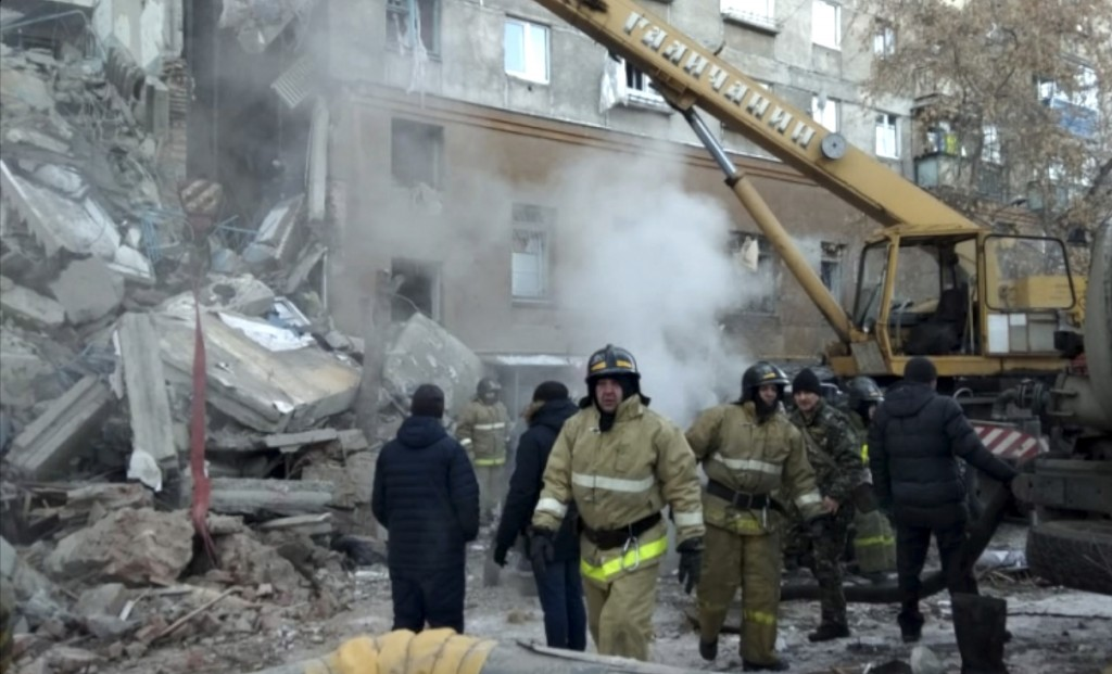 This photo provided by the Russian Emergency Situations Ministry taken from tv footage shows Emergency Situations employees working at the scene of a ...