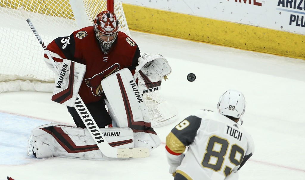 Arizona Coyotes goaltender Darcy Kuemper (35) makes a save on a shot by Vegas Golden Knights right wing Alex Tuch (89) during the second period of an ...