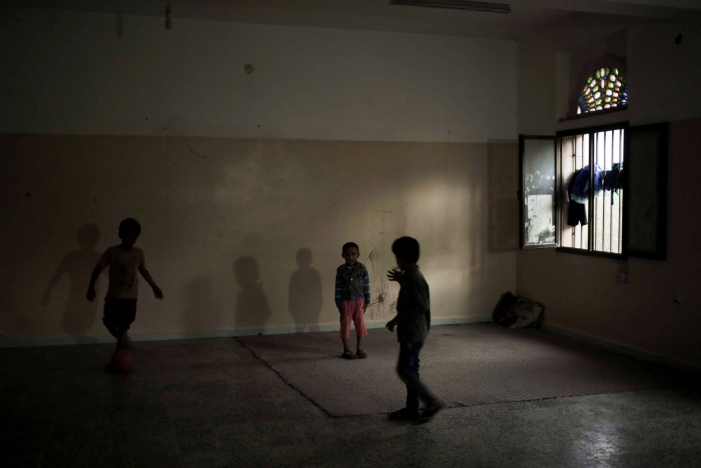 Children play in a room at a shelter for displaced persons in Ibb, Yemen, in this Aug. 3, 2018, photo. The U.N. and other global aid organizations est...
