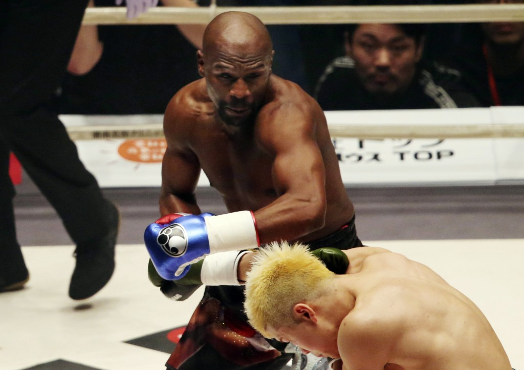 Floyd Mayweather Jr. delivers his left to Japanese kickboxer Tenshin Nasukawa, during their three-round exhibition match on New Year's Eve, at Saitama...