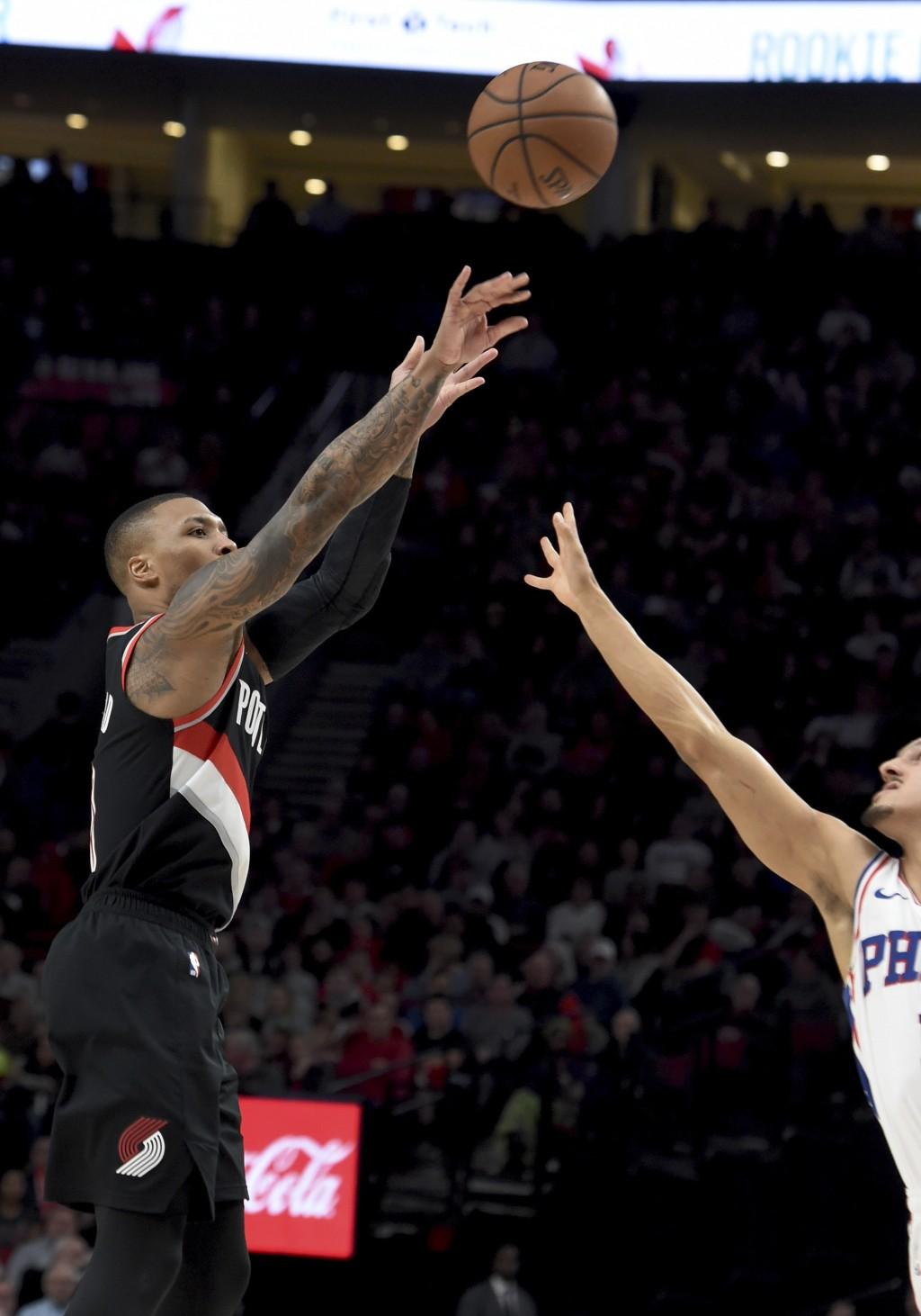Portland Trail Blazers guard Damian Lillard hits a shot during the second half of an NBA basketball game against the Philadelphia 76ers in Portland, O...