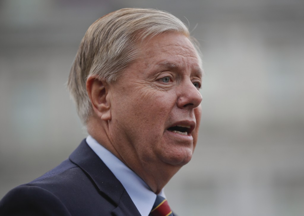 Sen. Lindsey Graham, R-S.C., speaks to members of the media outside the West Wing of the White House in Washington, after his meeting with President D...