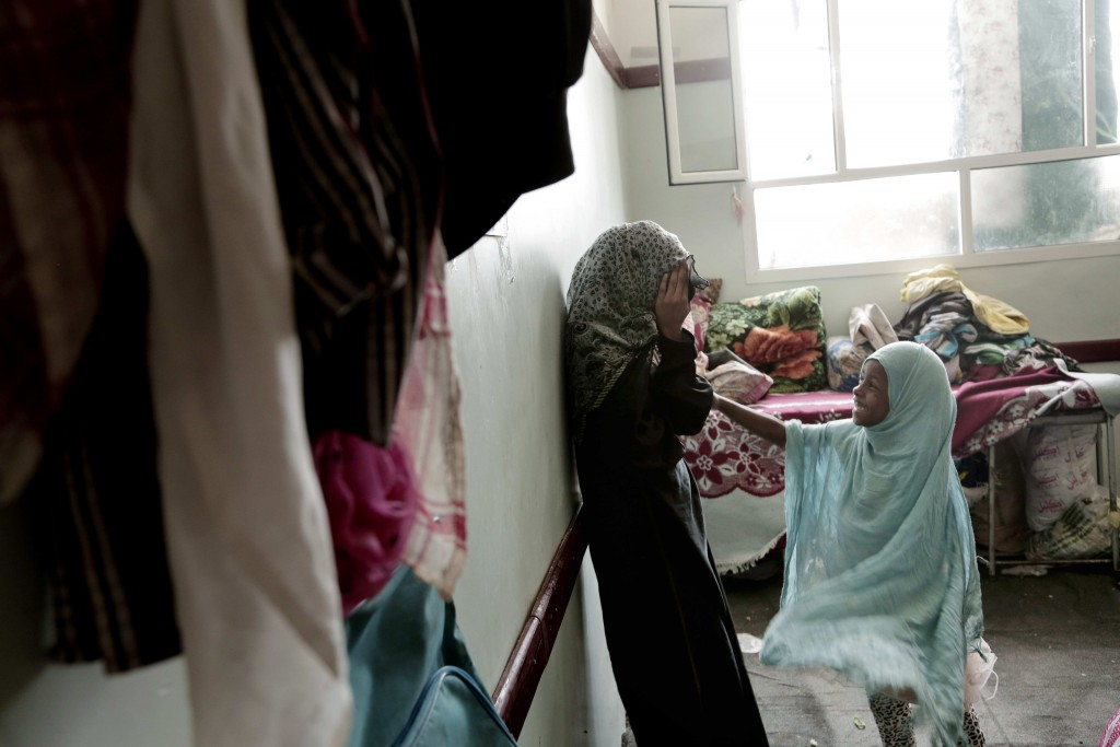Sisters play in their room at a shelter for displaced persons in Ibb, Yemen in this Aug. 3, 2018, photo. An AP investigation found that large amounts ...