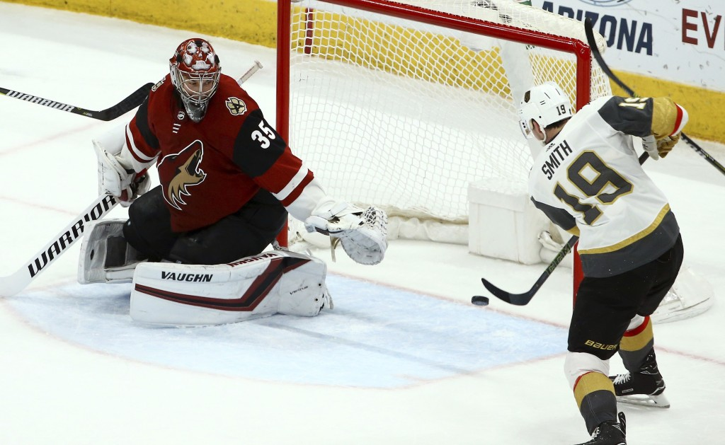 Vegas Golden Knights right wing Reilly Smith (19) scores a goal against Arizona Coyotes goaltender Darcy Kuemper (35) during the second period of an N...