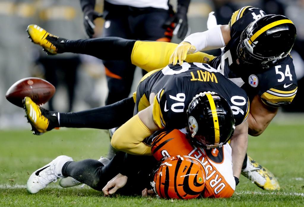 Cincinnati Bengals quarterback Jeff Driskel, bottom, loses the ball as he is hit by Pittsburgh Steelers outside linebacker T.J. Watt (90) and lineback...