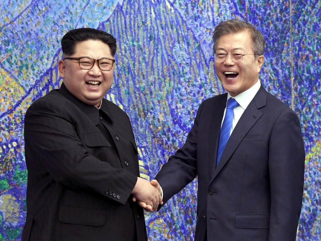 FILE- In this April 27, 2018, file photo, North Korean leader Kim Jong Un, left, poses with South Korean President Moon Jae-in for a photo inside the ...